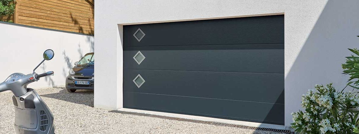 Pose porte de garage sectionnelle